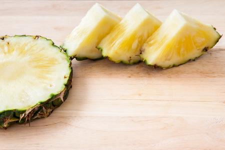 pineapple slice: pineapple slice on wooden background