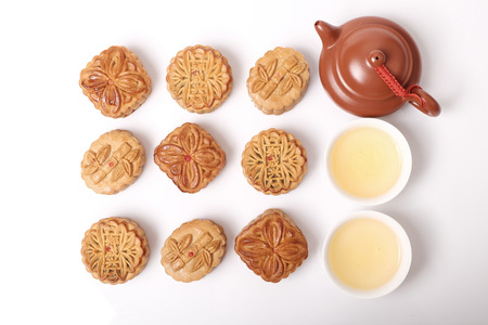 Moon cakes and tea for the Chinese Mid-Autumn festival, on white background Stock Photo