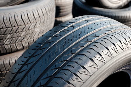 traction: Close up of tyre tread texture, Tread of used car tires, Tread worn tires.