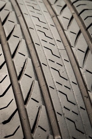 Close up of tyre tread texture, Tread of used car tires, Tread worn tires.