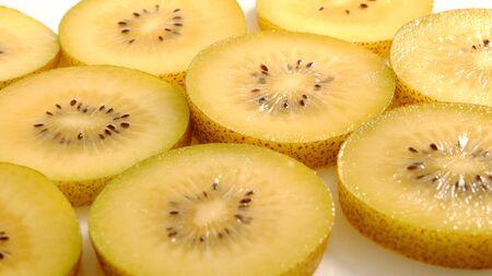 Seamless pattern of slice yellow kiwi fruit(or gold kiwi) on white as background