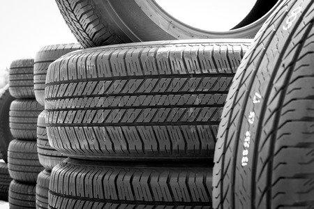 Close up of stack used car tires, tyre or rubber.