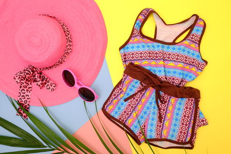 Summer fashion: Clothing and accessories for beach on colorful background.