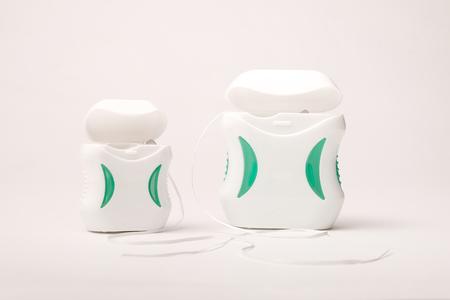 Dental care; Dental floss on white background.