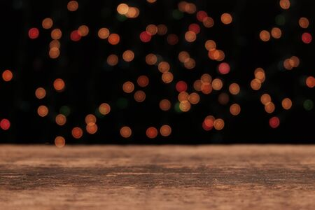 Festive background, Wooden table in front of light bokeh background, Reklamní fotografie