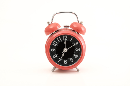 Red vintage alarm clock with space for text on white background.