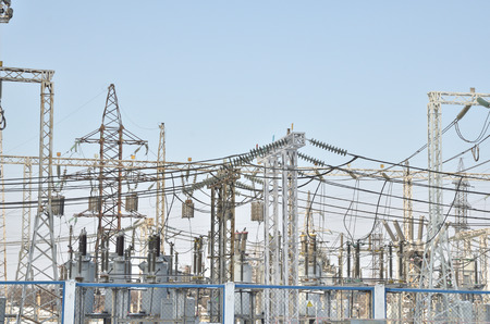 High-voltage transformers and power line supports. blue sky without clouds. Russia. Siberia. Power station.