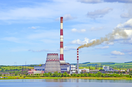 thermal power plant. View from the side of the lake. Summer. Russia. Siberia