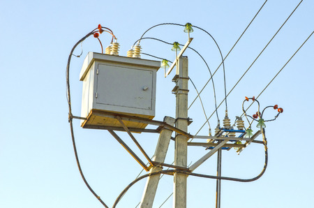 Voltage-reducing transformer is installed on the high-voltage transmission line support. Russia.