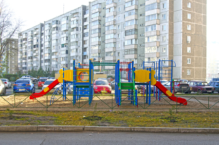 Childrens playground in the courtyard of the apartment building. Russia. Siberia. Autumn
