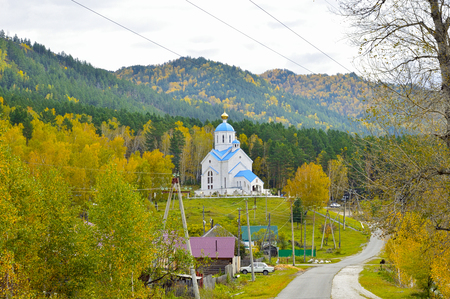 Ancient church between mountains and forests. Russia