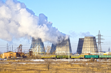 Territory of heat and power station. Accumulator tanks and cooling towers. Winter. Russia