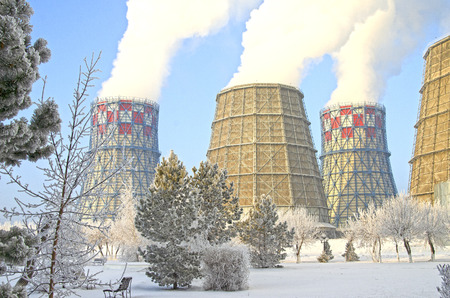 Territory of heat and power station. Accumulator tanks. Close-up. Winter
