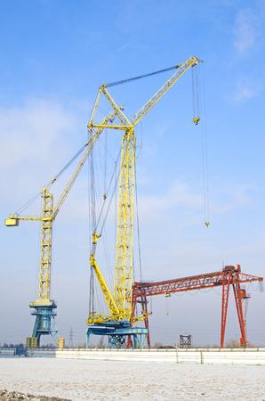 Several tower cranes. gantry cranes against the blue sky. Russia Banco de Imagens