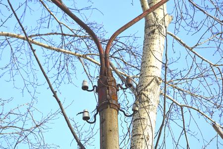 Old, burnt due to lightning, high-voltage power line pylon. Banco de Imagens