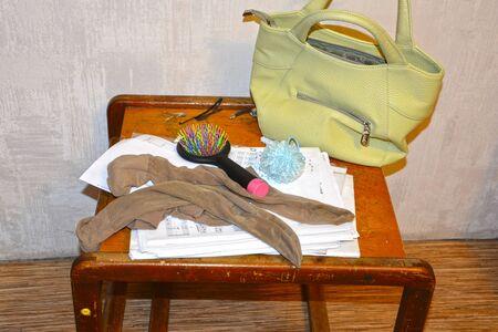 Women's worn, dirty nylon socks on a small table. Fetish Stok Fotoğraf