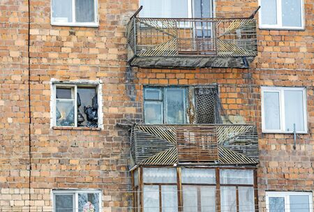 Old windows with bags of food posted on the street. Poor people in an apartment building in the outback of Russia