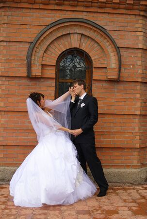 Bride and groom meet at a church court Stock Photo - 2725320