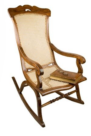 antique chair: Ancient an armchair-rocking chair. Many people like to have a rest in it