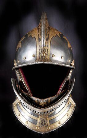 knight helmet: Iron helmet of the medieval knight. Very heavy headdress. Stock Photo