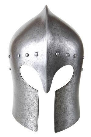 a helmet: Iron helmet of the medieval knight. Very heavy headdress. Stock Photo