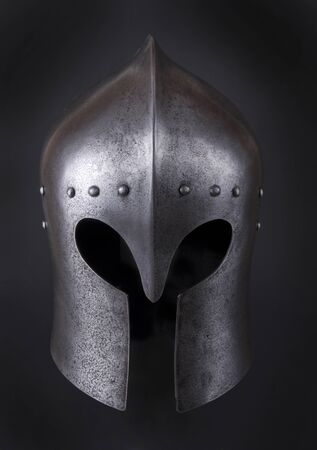 the medieval: Iron helmet of the medieval knight. Very heavy headdress