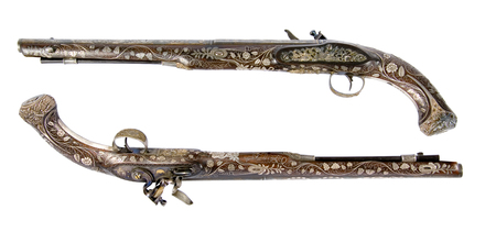 inlaid: Old pistol inlaid with bone and enamel. Ceremonial weapon