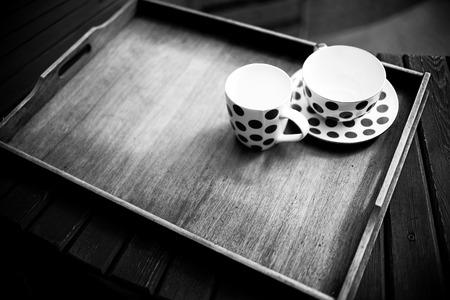tea service: Tea service on a wooden stand Stock Photo