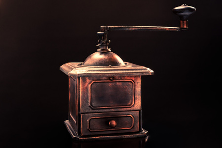 lifespan: Old coffee grinder on a black background Stock Photo