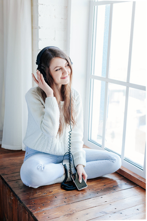 woman listening music with headphones. relax and unwind.
