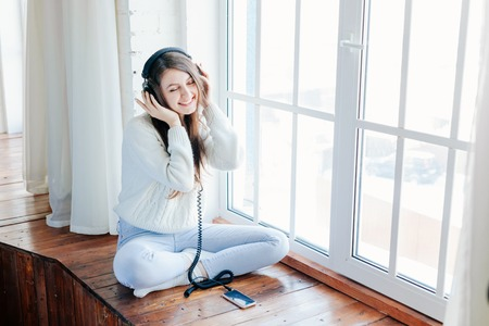 woman listening music with headphones. relax and unwind. Imagens - 52302277