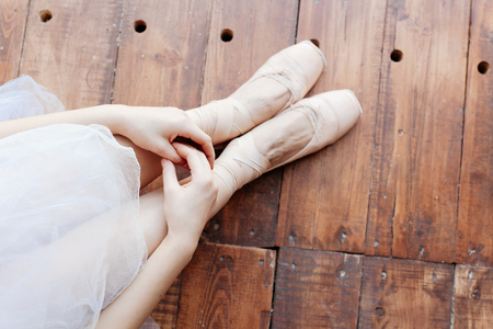 ballerina tights: Young ballerina standing on poite at barre in ballet class. Stock Photo