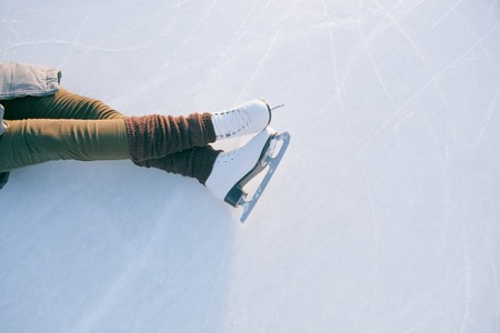 Tilted blue version, ice skates with reflection.