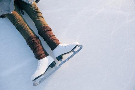 tilted: Tilted blue version, ice skates with reflection.