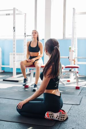 Beautiful sporty women in gym have rest