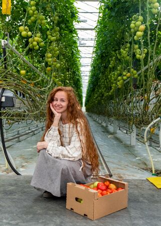 Scientist inspecting plants. Woman agronomist in greenhouse. Portrait of a Young Female Working in the Garden Center. Woman scientist.