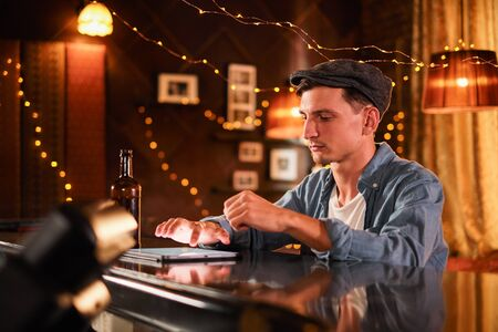 people and technology concept - happy man with smartphone drinking beer and reading message at bar or pub Imagens