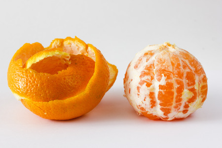 Emotion faces on mandarins photoset. Peeled mandarin. Stock Photo