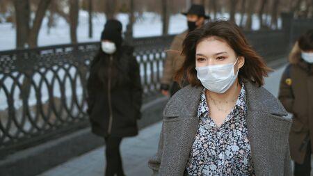 Wearing Respiratory protection Face Masks Korea. Korean City Street Crowd Walk real. Asian Covid-19 Coronavirus Mers. Chinese People. Lockdown 2019-ncov China.