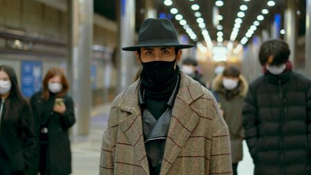 Asian Handsome Fashion Guy. Wear Black Stylish Respiratory Mask Cool-look Korea. Chinese People. Coronavirus Hipster Style China. Covid-19. Corona Virus Asia. Serious Face Man Young Adult Korean Model