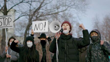 Man Scream Loudspeaker. Corona Virus China. Asian Crowd People Go Walk. Respiratory Face Mask. Rebel Protest. Strike Out. Asia Coronavirus Mers. Megaphone Shout. Chinese Revolution public. Covid-19. 写真素材
