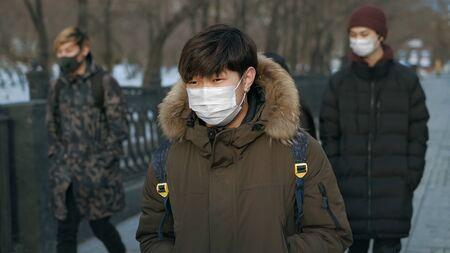 Corona Virus Flu. Wear Respiratory Protect Face Mask. City Street Crowd Walk real. Pandemic Covid-19 Epidemic Coronavirus Mers. SARS-CoV-2. Adult Young People Quarantine. Lockdown 2019-ncov.