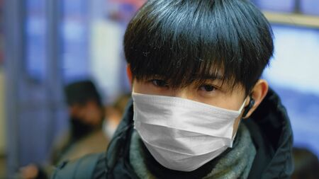 Masked Asian Man Real. Protect Ill Flu Coronavirus. Asia Health Care. Environment China Air Pollution . Illness Protection Corona Virus Chinese Infect . Allergy Human Respiratory Face Mask. SARS-CoV-2 写真素材