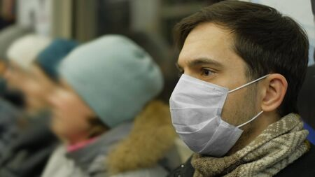 Corona Virus. Man in Face Mask Covid-19. Subway Station. Epidemic Coronavirus Mers. Pandemic Flu. Human Masked 2019-ncov. Train Metro Tube. People. Male Health Care. Smog Air Filter. 写真素材