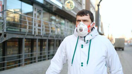 One European Man Go Walk. Corona Virus Flu Mers. Real People N95 Mask. Coronavirus State of Emergency. Flatten the Curve Covid-19. Social Distancing 2019-ncov. Male outdoor Europe. 写真素材