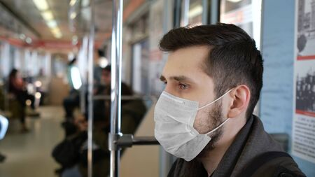 One European Man Public. Epidemic Corona Virus Flu Mers. Real People. Face Mask. Coronavirus State of Emergency Europe. Flatten the Curve Covid-19. Pandemic Social Distancing 2019-ncov. Male Metro. 写真素材