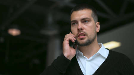Successful white collar business man walking and talking on phone close up with serious face 4K. Business people speaking on mobile with partners. Manager walk and talk on phone with work colleagues.