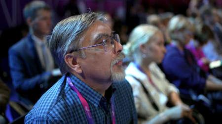 Russia, Novosibirsk, 21 sep, 2019: Crowd people listen speaker. Audience business meet forum. Auditorium viewer listen speaker. political summit business man. Group people listening speech crowd. 写真素材 - 156208844
