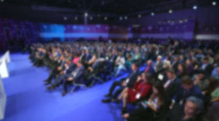 Audience business meeting crowded forum person. Viewer seminar education listen speaker large auditorium. Event political summit business man spectator. Group people listening speech crowd audience.
