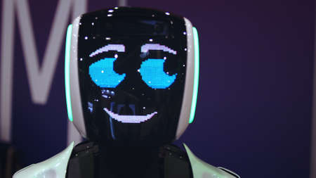 Beautiful portrait robot pulse heart on digital display pixel smile closeup looking at camera 4K. design sweet cyborg demonstrate 8 bit love. heart beat smiling android with feeling loving for people.